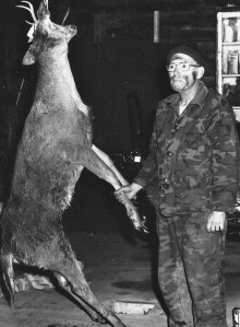 Al Johnson with the first deer he took with a bow, age 52, 1977.